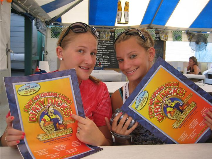 two females holding menus