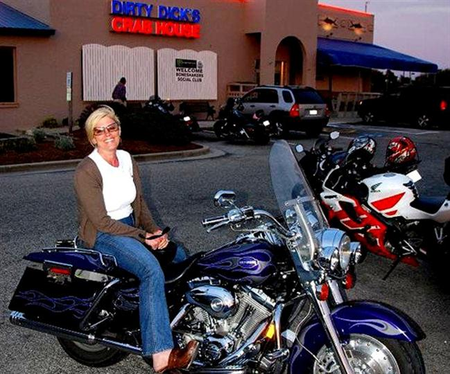 female sitting on motorcycle
