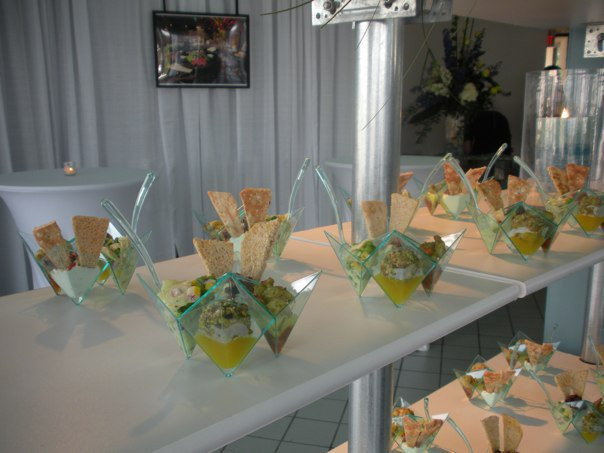 A buffet with personal moder geometric salad bowls