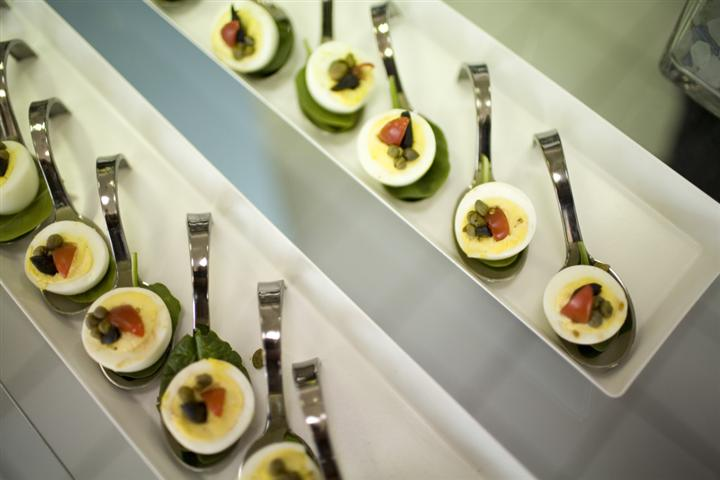 Trays with deviled eggs served on spoons