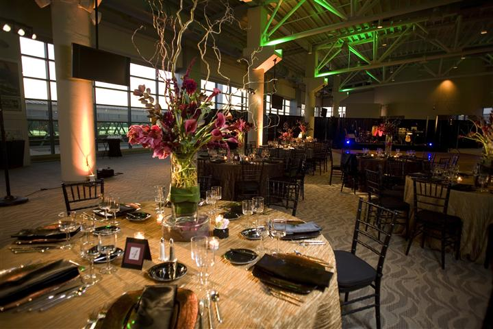 Interior shot of a decorated hall with round tables