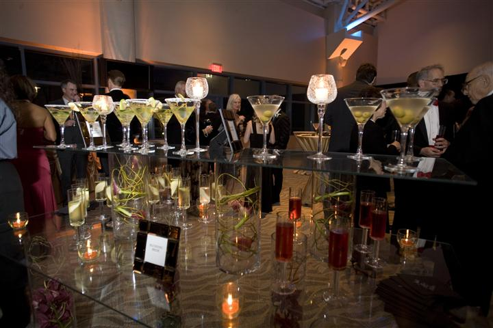 A glass buffet with several cocktails