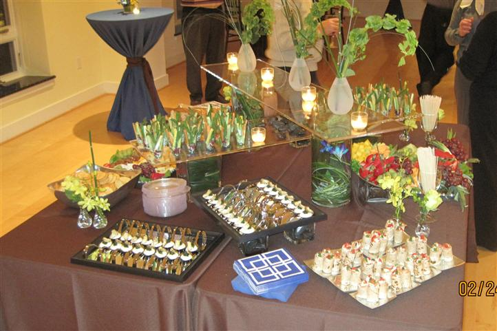 Α square buffet with several trays of fingerfood