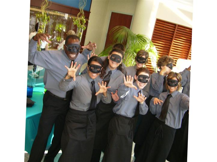 The Chesapeake Bay Catering servers  wearing masks posing for photo