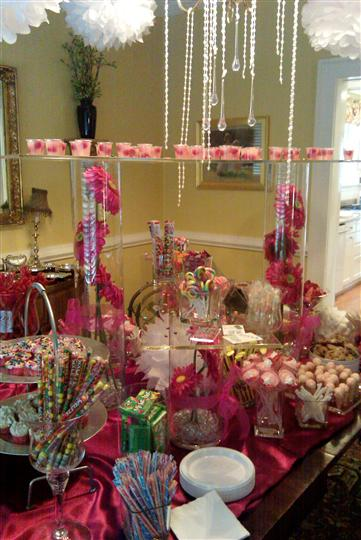 A buffet with several trays and fuchsia decoration