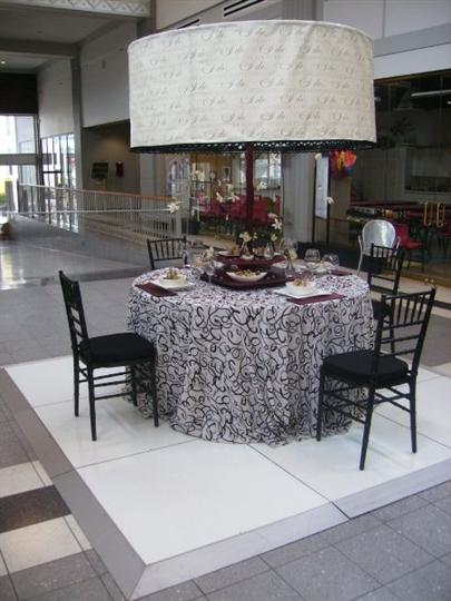 Interior decoration of a round table with black and white table cloth