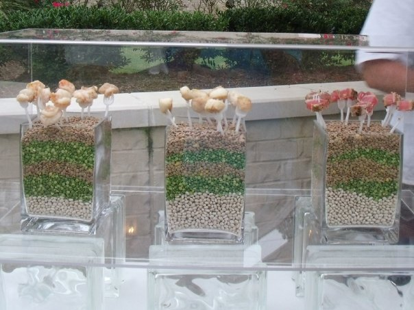A glass buffet with appetizer bites at a garden party