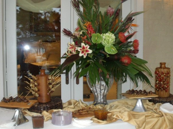 Interior photo of a bouquet on a buffet with serveral trays