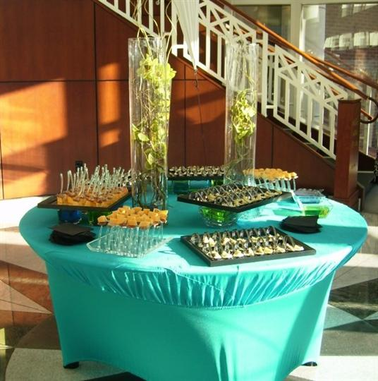 Several trays on a round buffet