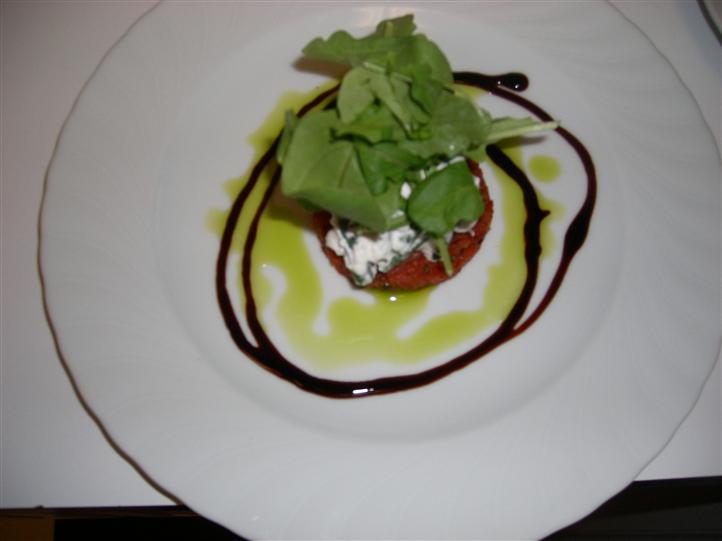 A salad served with vinaigrette cream