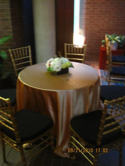 A round table with a golden table cloth
