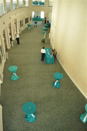 A corridor decorated in light blue and white