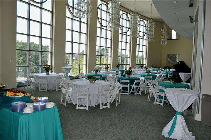 A reception hall decorated in light blue and white
