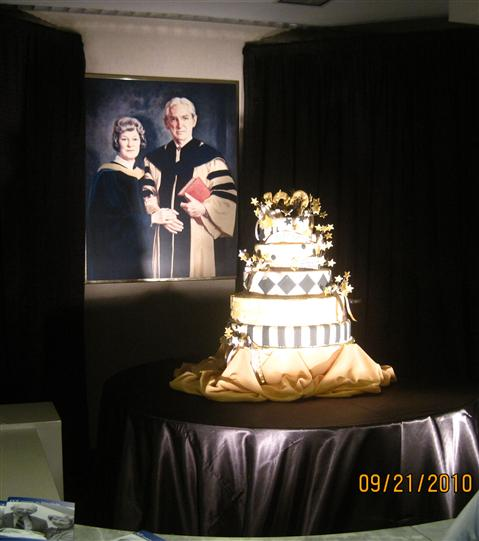 A four level black & white cake on a table