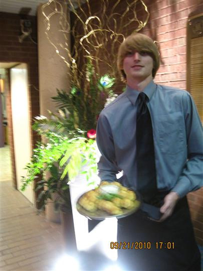 A server holding a tray posing for a photo