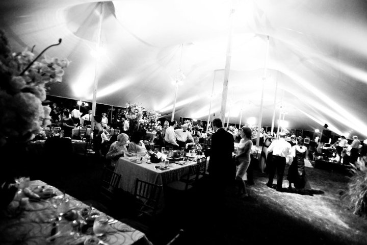 A black & white wedding reseption photo under a tent