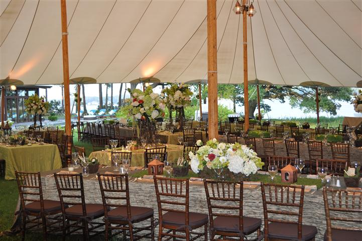 A tent with tables for a wedding reception