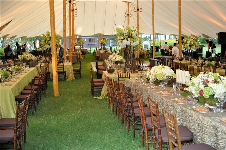 Tables under a tent for a wedding reception