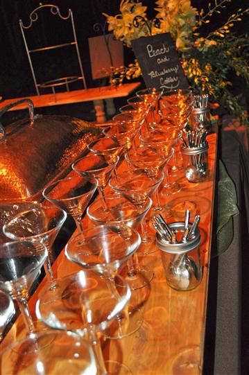 A buffet with cone glasses