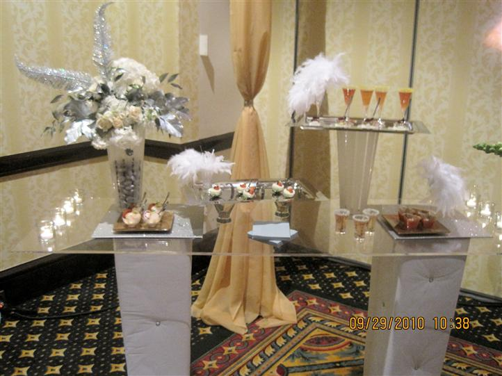 Several desserts and drinks on glass buffets