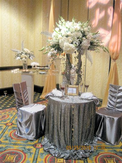 A round table for two with silver decoration