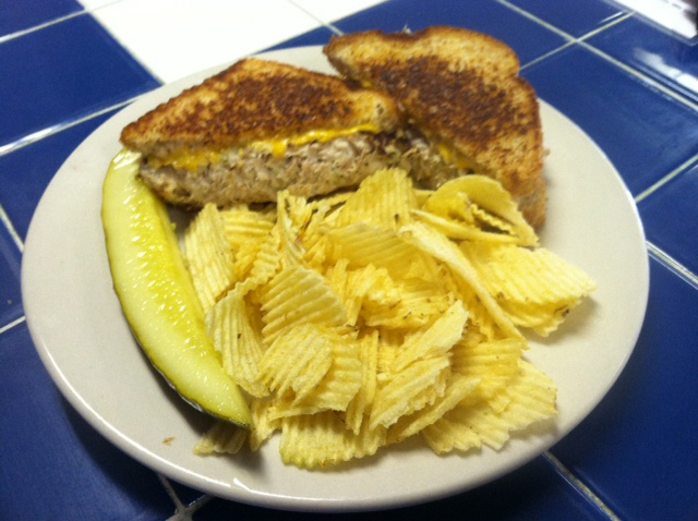 tuna sandwich with chips and pickle