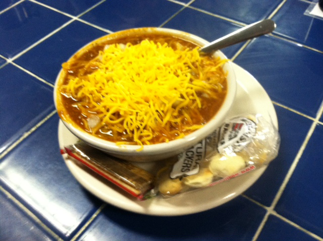 bowl of chili with cheese and oyster crackers