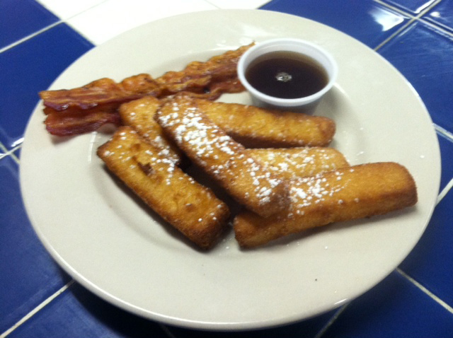 french toast sticks with syrup and bacon