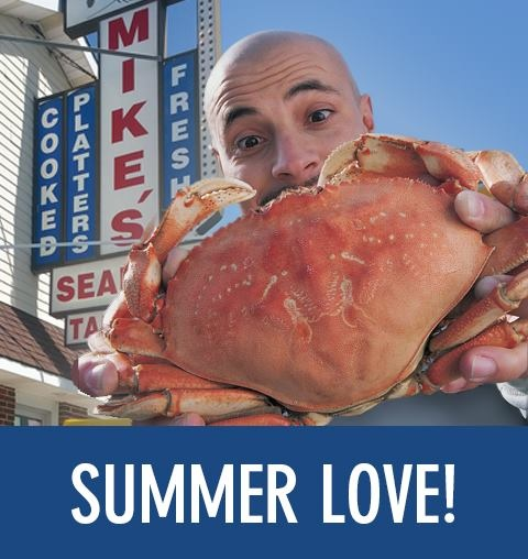 "a man holding a crab in front of mike's seafood with the text ""summer love!"""