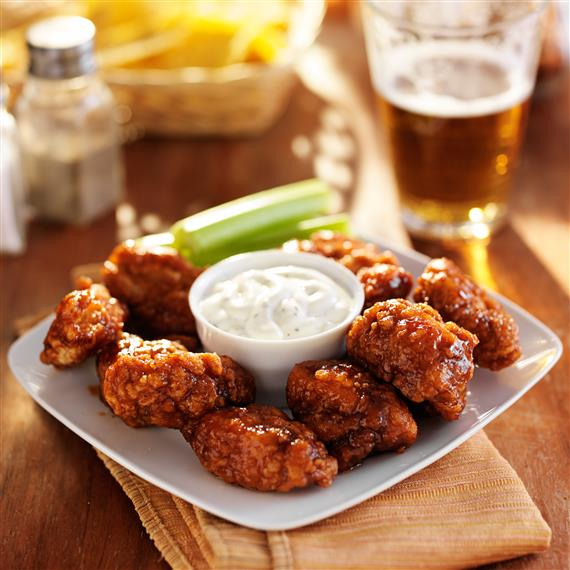 wings with dipping sauce and a beer