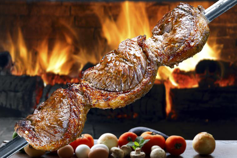 samba meat skewer over fire with veggies.jpg