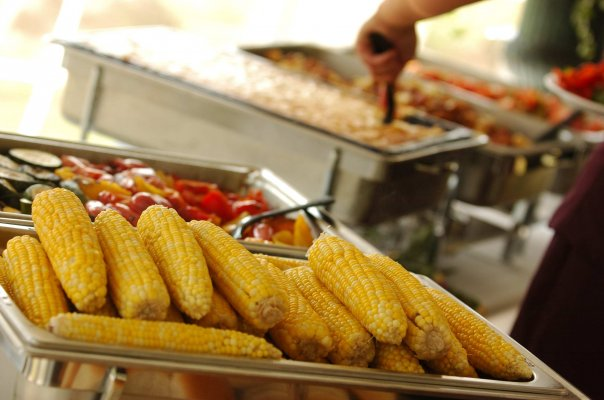 corn with catering trays of peppers