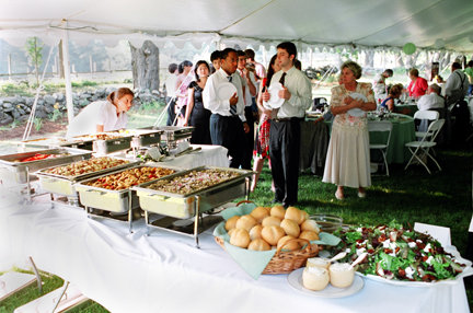 catering food displey with many people