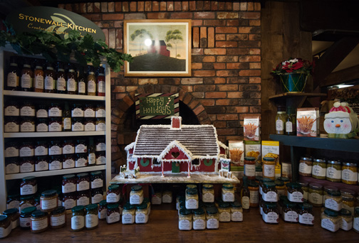 Vermont Countrgingerbread house display with sauces in front y Deli