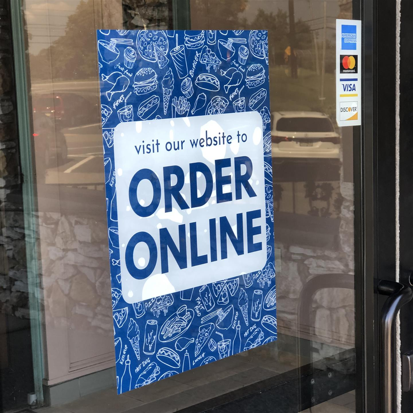 Order Online Sign on the front door