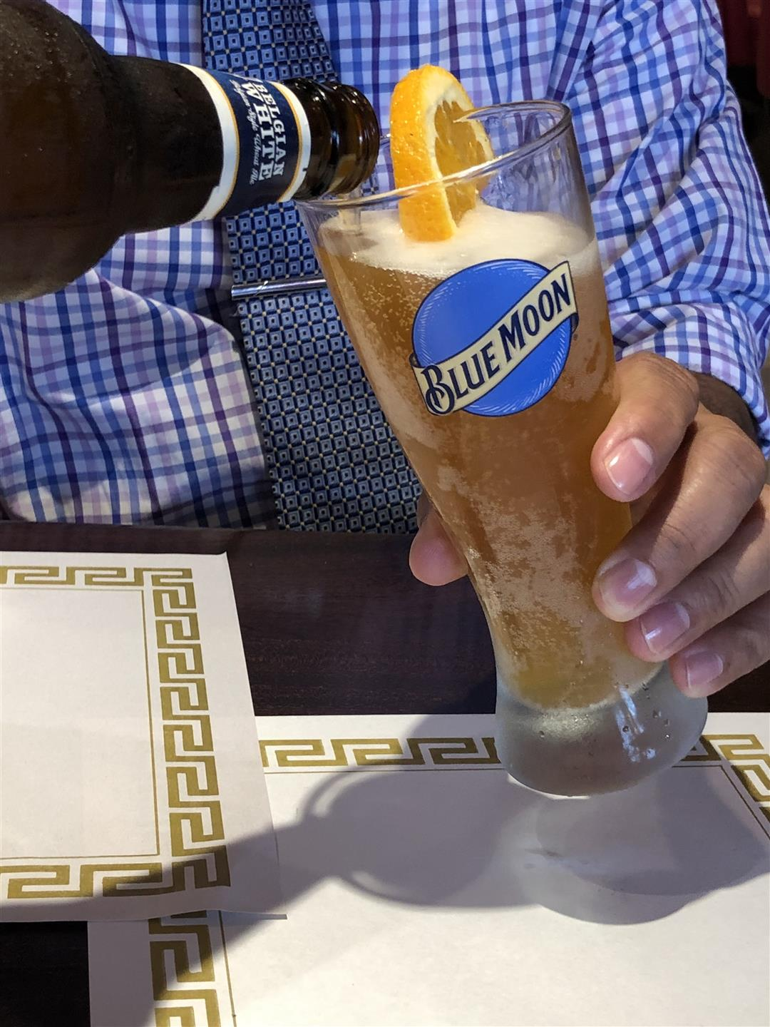 Blue Moon Beer being poured into a cup