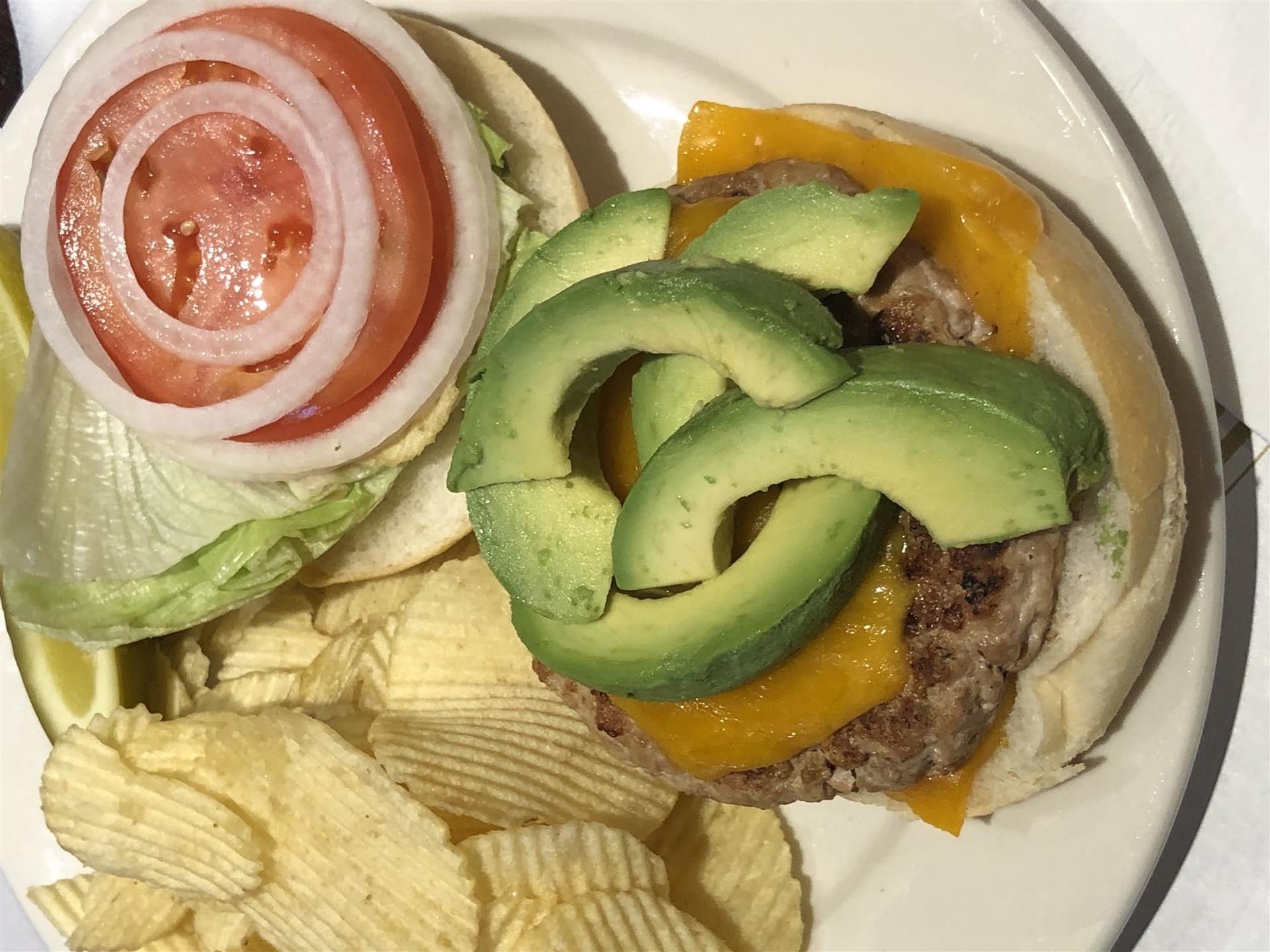 Turkey burger with avocado, tomato, lettuce, onion