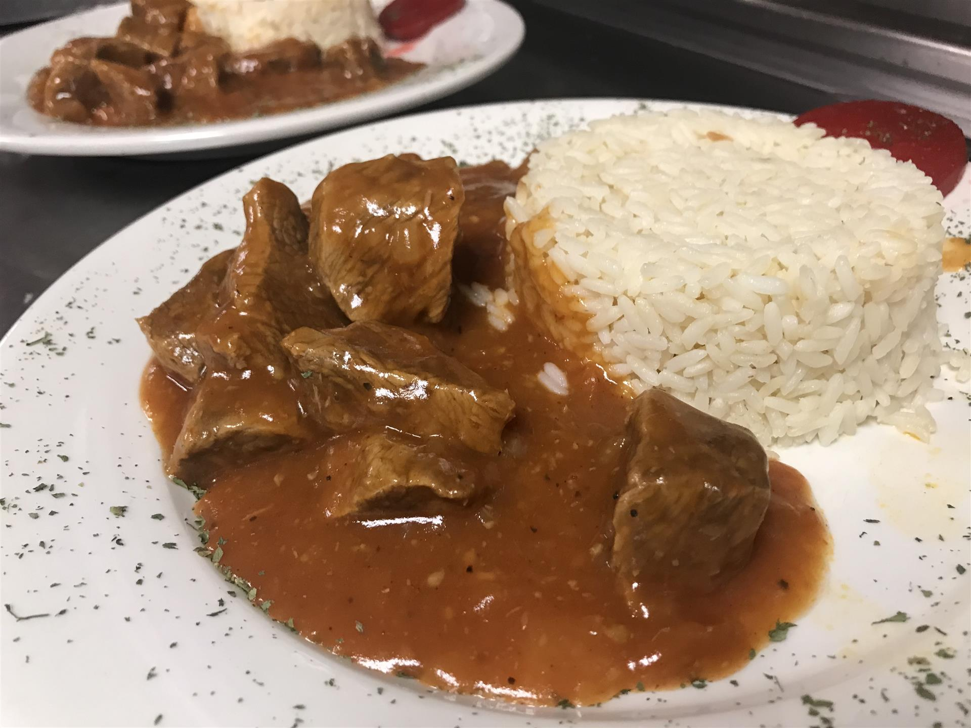 beef goulash with rice on a plate