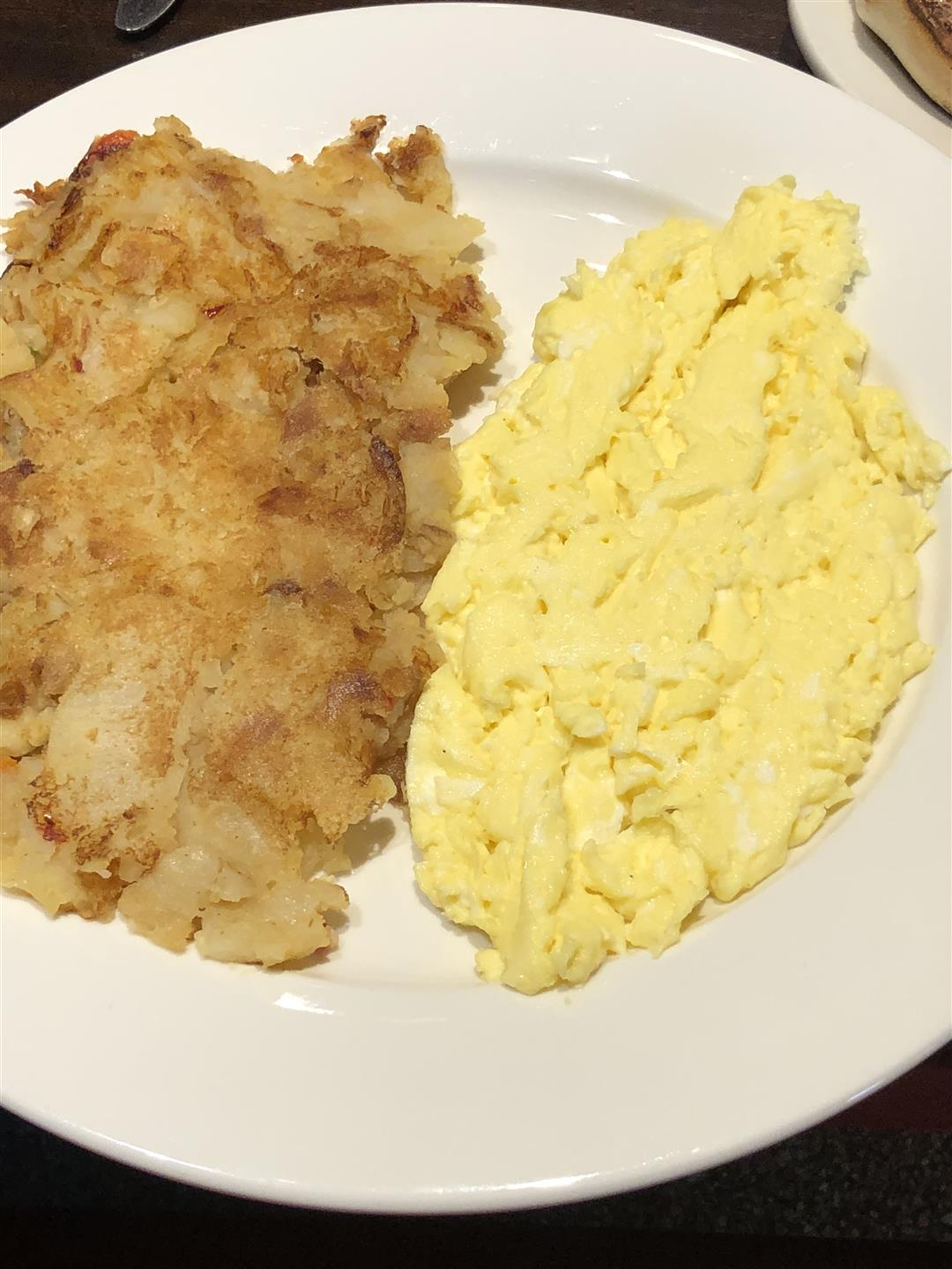 hash browns, and scrambled eggs on a plate