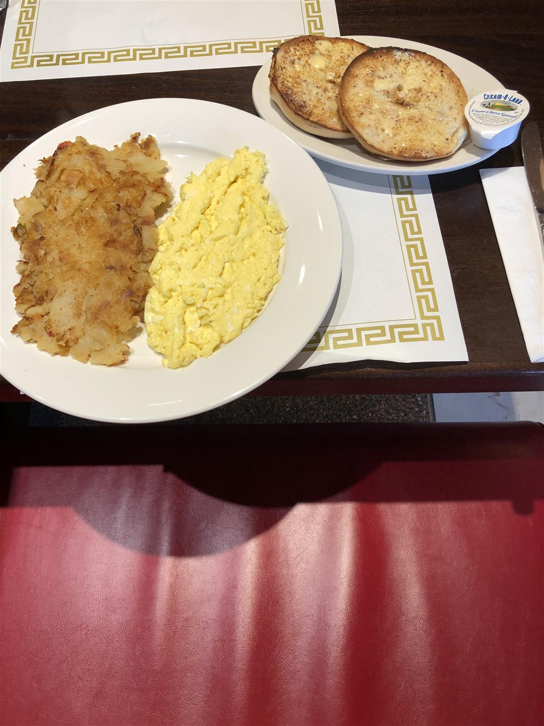 hash browns, scrambled eggs and a toasted bagel on a plate