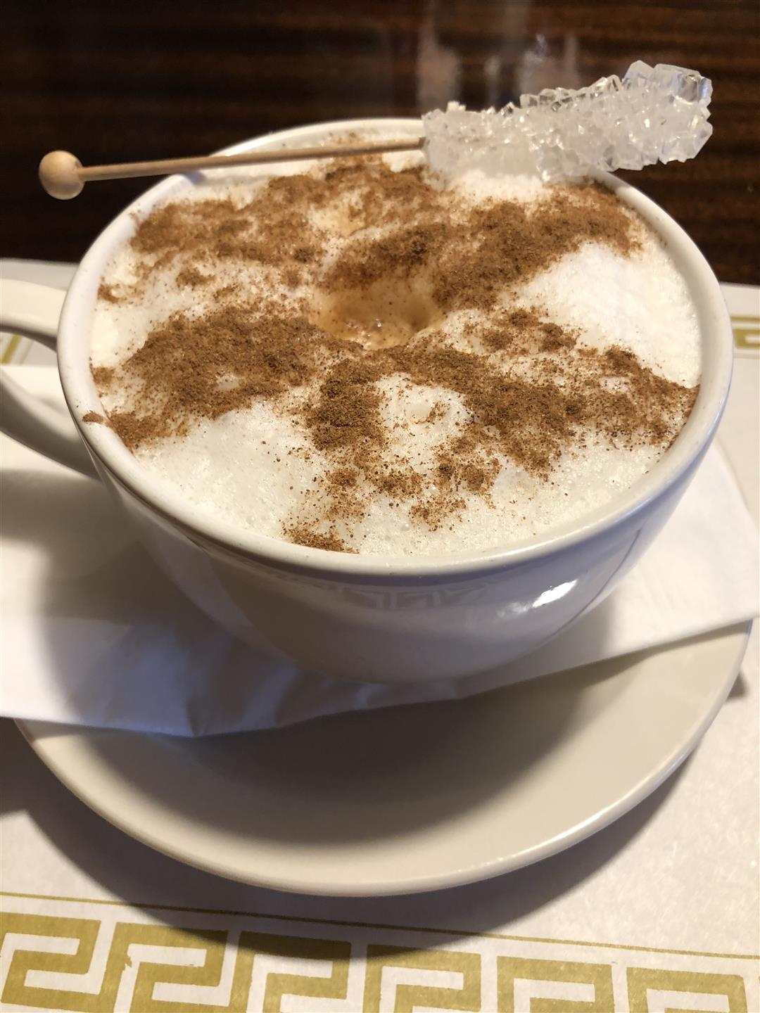 latte with rock candy on top