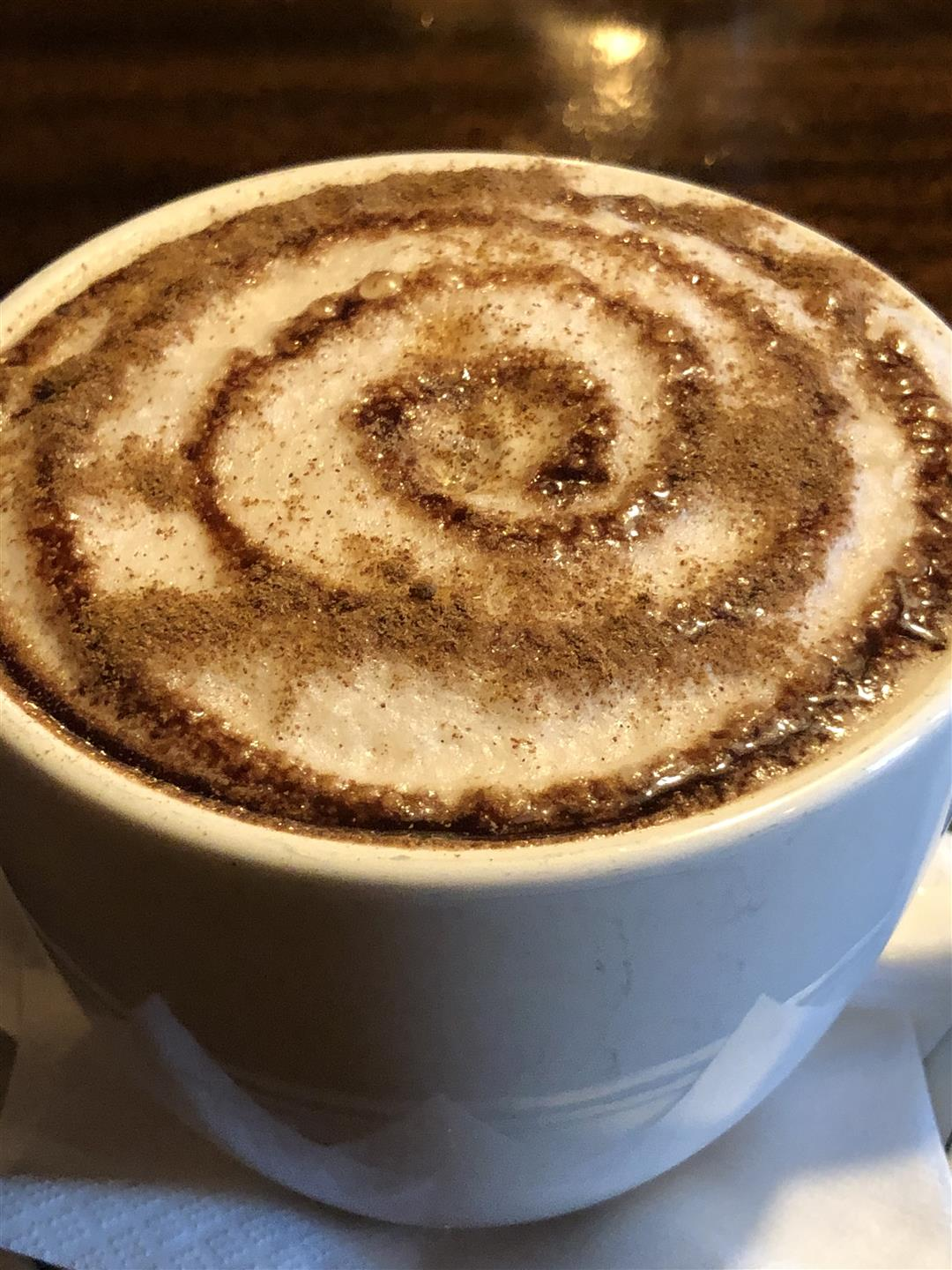 A hot chocalte with a swirl on top
