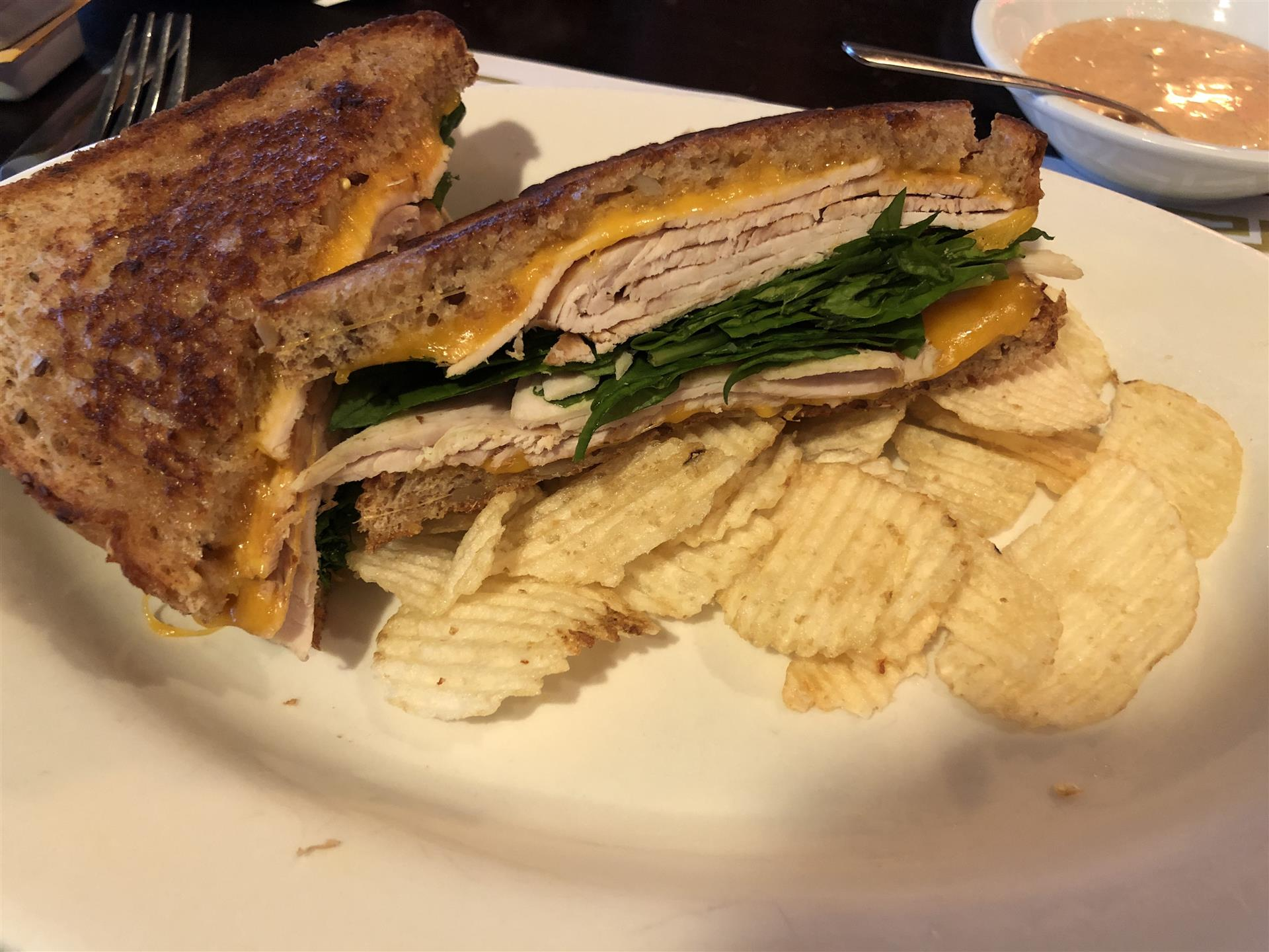 turkey, spinach and cheese melt, with a side of chips