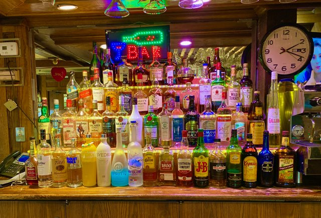 bar with various alcoholic beverages