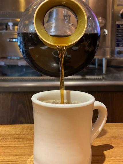 coffee being poured into a mug