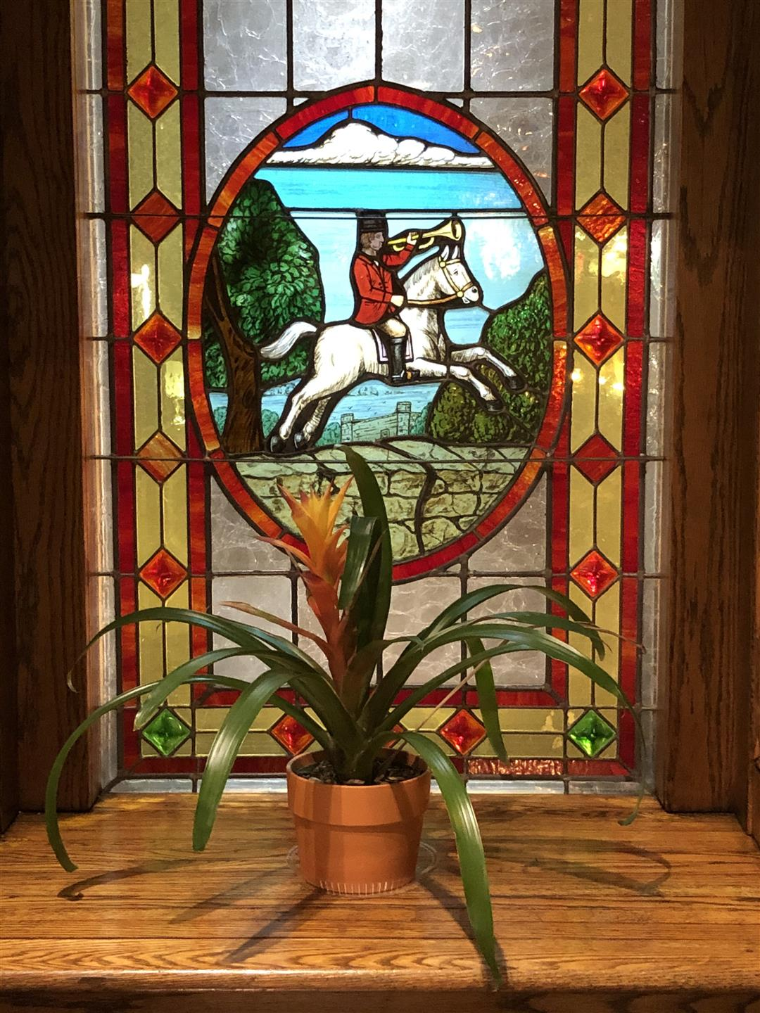 stained glass windows with a man riding a horse