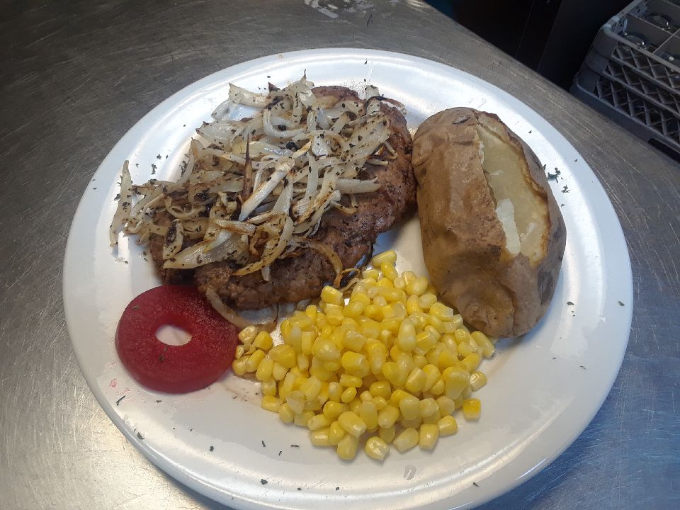 Black Angus Chopped Steak with Grilled Onions & Mushrooms and a side of corn adn a baked potato