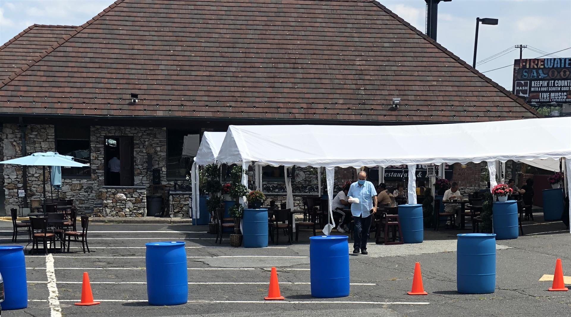 Outdoor dining with tents at Coach House Diner of Hackensack