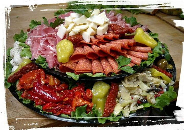 Assortments of Deli cut meats, Peppers, Cheese on a platter