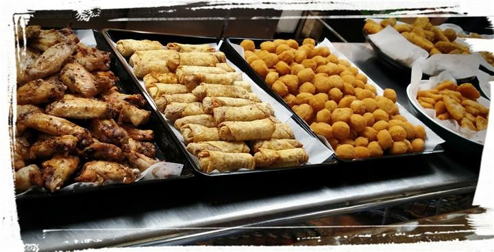 Assortment of Eggrolls, Chicken wings, and fried nuggets